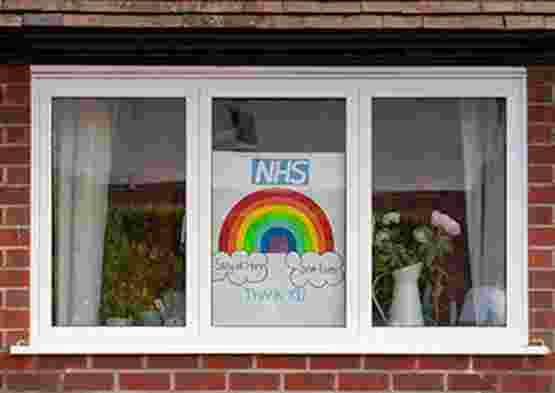 NHS rainbow picture in window